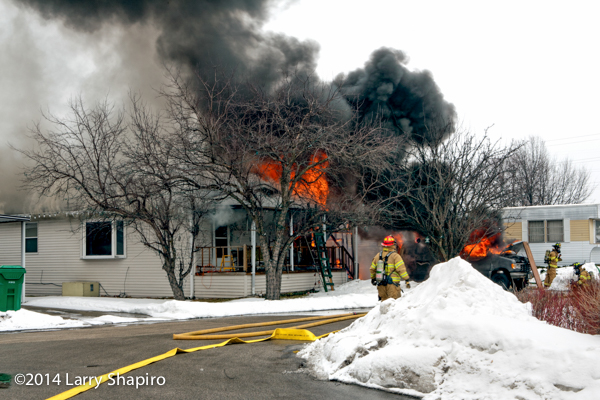 heavy smoke and flames from winter mobile home fire