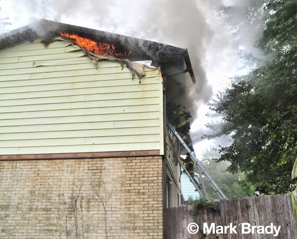 smoke and flames from house fire