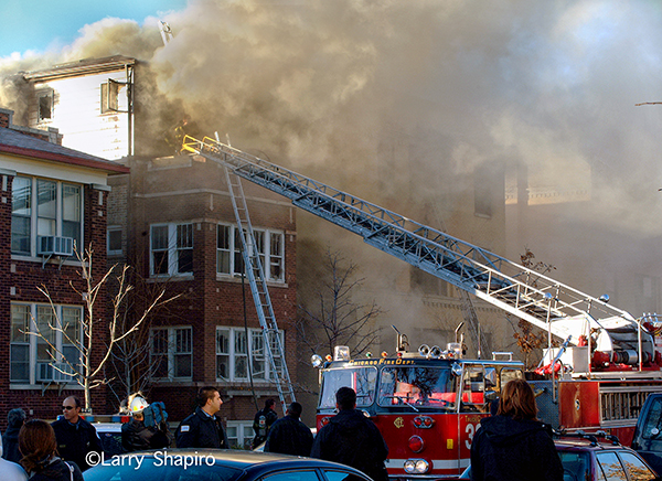 heavy smoke from top floor of Chicago home