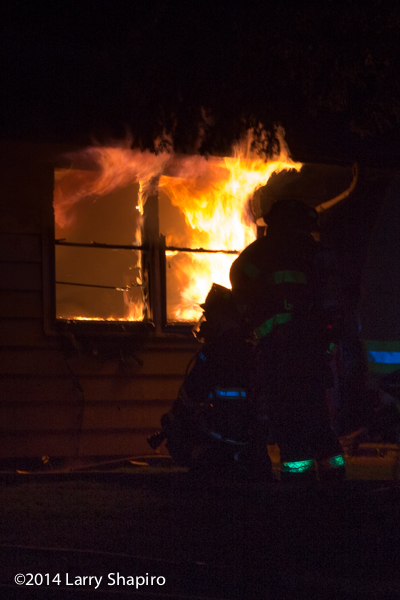 silhouette of firefighter at house fire
