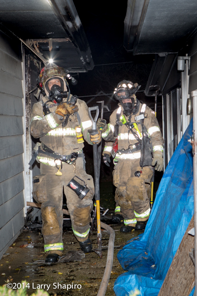 firefighters exiting a house fire