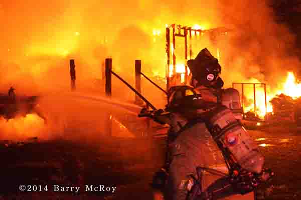 firemen battle mobile home fire at night