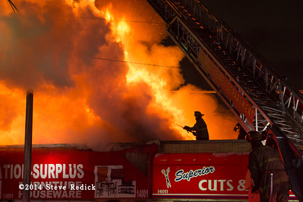 heavy flames from a commercial building fire at night