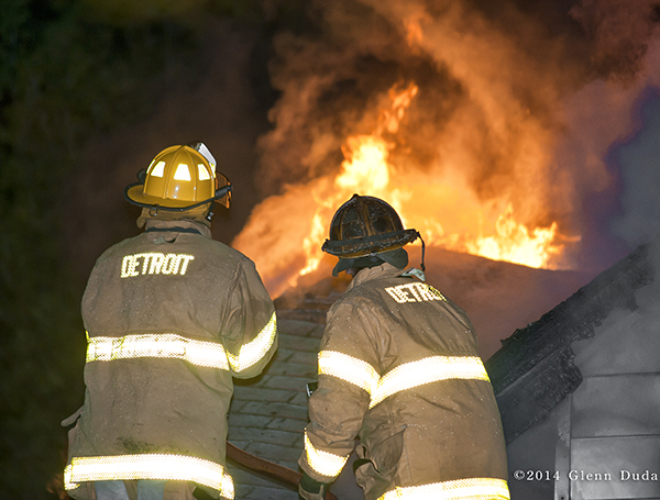 Detroit firefighters at night fire scene