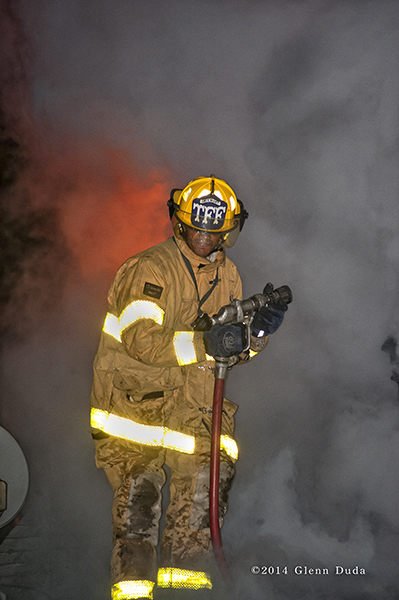 Detroit firefighter at night fire scene