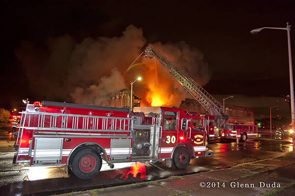 Detroit fire engines at huge night fire scene