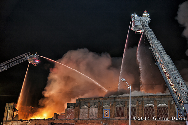 Sutphen tower ladders fighting massive fire