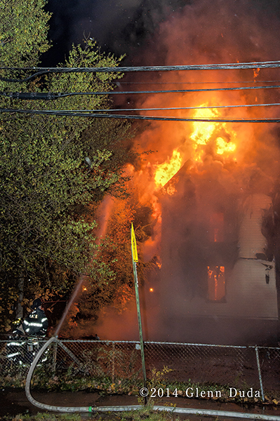 fully-engulfed house destroyed by fire at night