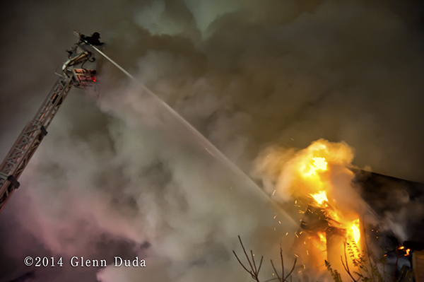 night fire scene with Sutphen aerial tower