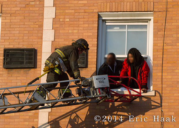 fireman rescues residents from apartment building via ladder