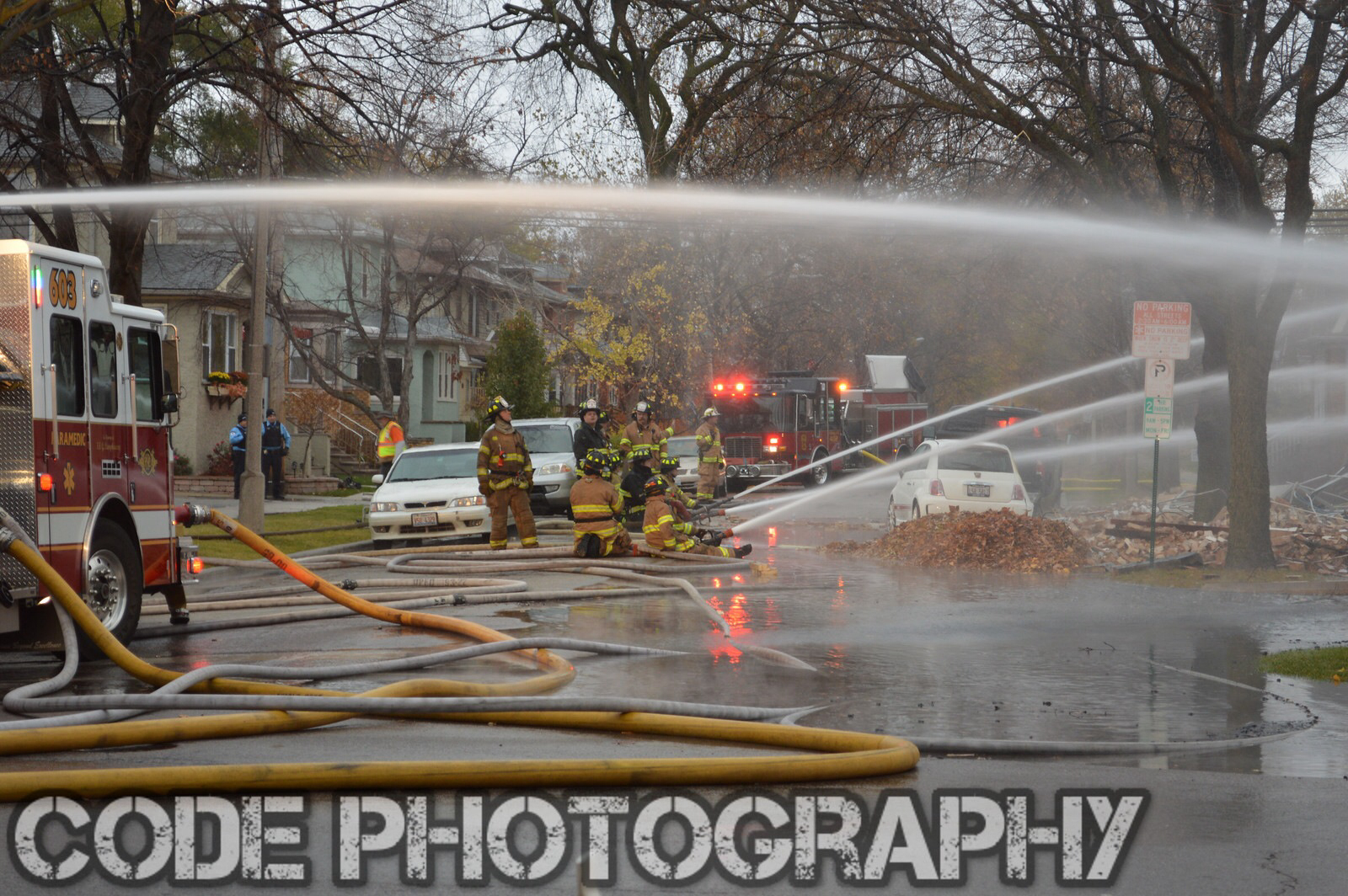 multiple hose lines working at fire scene