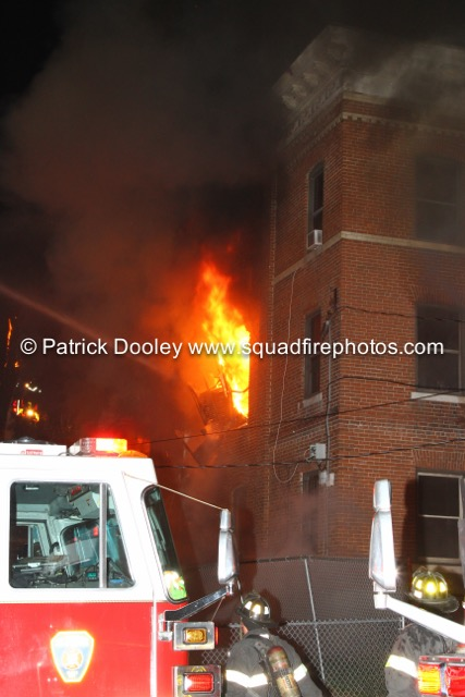 fire blows out the 2nd floor window