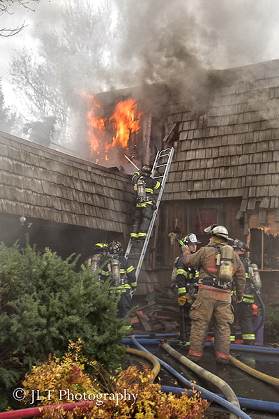 house fire with mansard roof