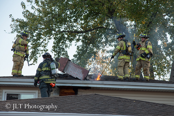 firemen on roof of a house