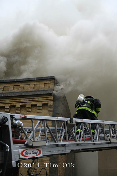 firemen battle fire with heavy smoke