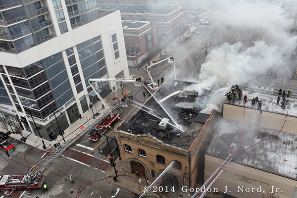 aerial view as firemen battle fire with heavy smoke