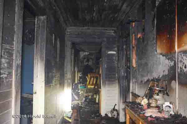 charred interior of house after fire