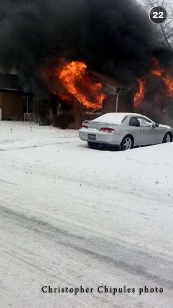 garage fully engulfed in flames