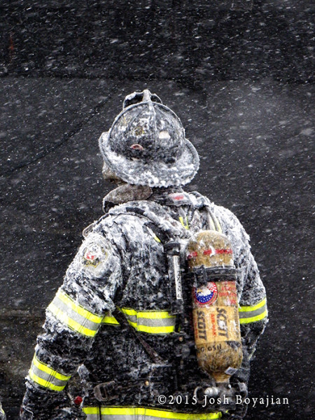 fireman covered with snow and ice