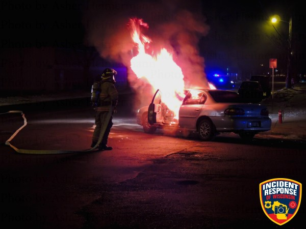 fireman fights car fire at night