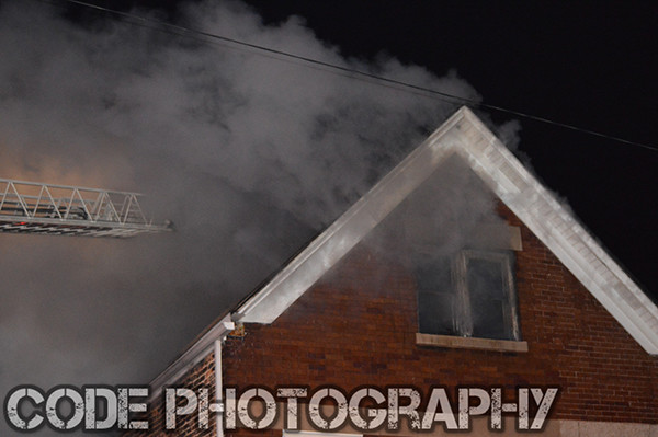 smoke from house at night