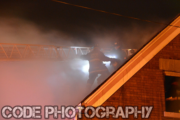 fireman at night on roof with smoke