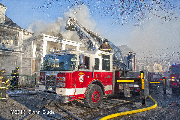 Pierce tower ladder at winter fire scene on Passaic NJ