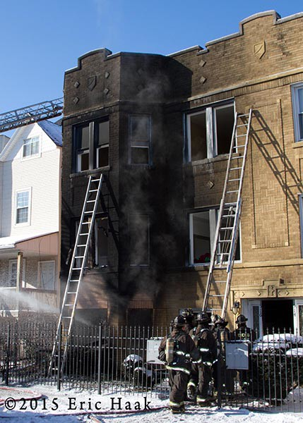 apartment building charred  after fire