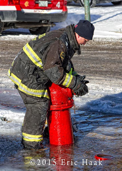 firemen in the cold with hydrant