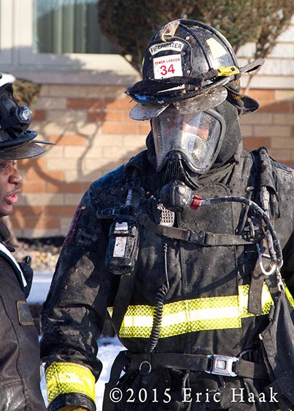 fireman with helmet and air mask