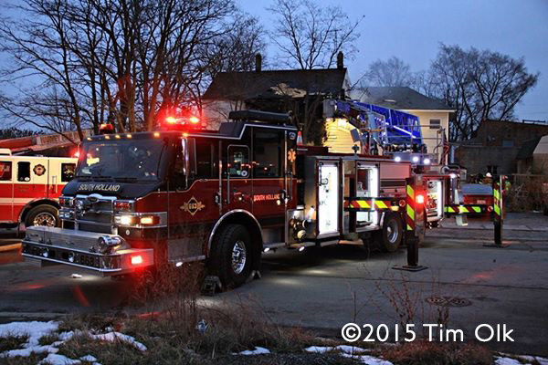 fire truck at house fire scene