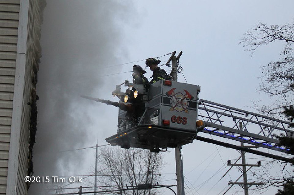 firemen in bucket with heavy smoke