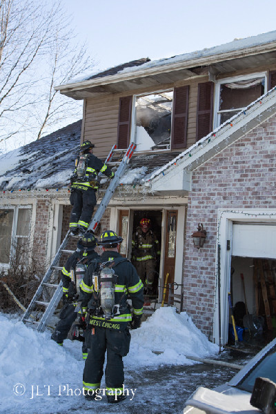 firemen at house fire