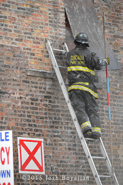 firemen on ladder with pike pole