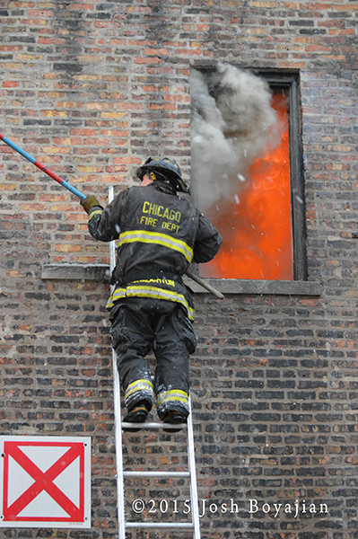 firemen on ladder with smoke and pike pole