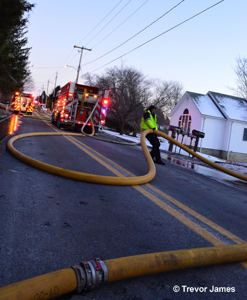 hose in the street at fire scene
