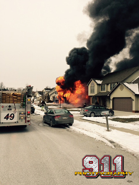 huge flames and black smoke from garage fire