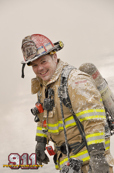fireman covered with foam
