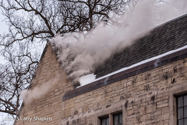smoke escaping from a building on fire
