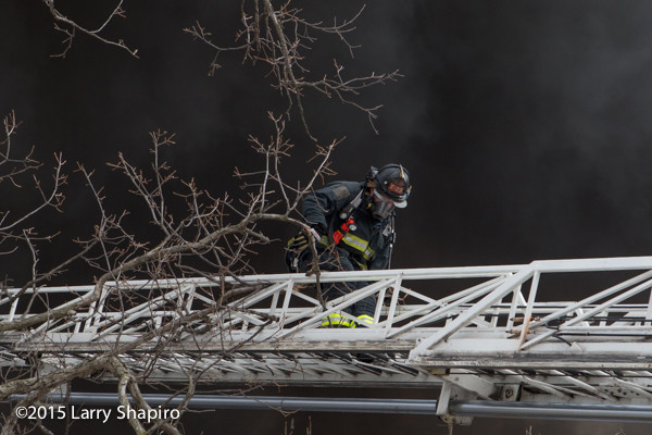 fireman on ladder with black smoke