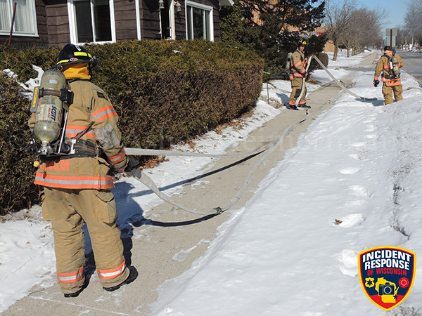 firemen rolling hose after fire