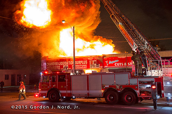 Detroit fire truck with huge fire at night