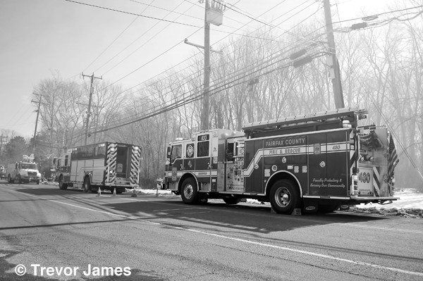 black and white photo of fire trucks