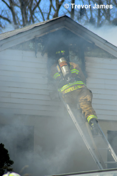 fireman on ladder at house fire