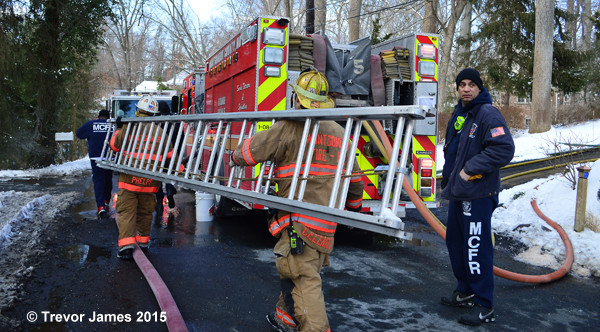 firemen carry a ladder