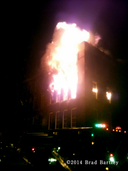 building fully engulfed by fire at night
