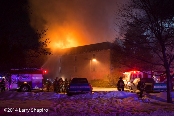 apartment building fire in the winter at night