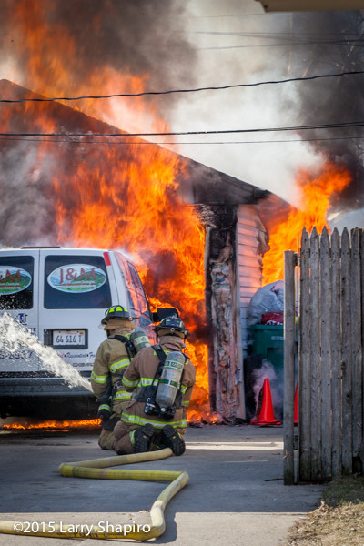 Firemen battle a garage fire in Wheeling, IL 3/17/15. Larry Shapiro photo