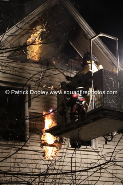 fireman in tower ladder platform at night