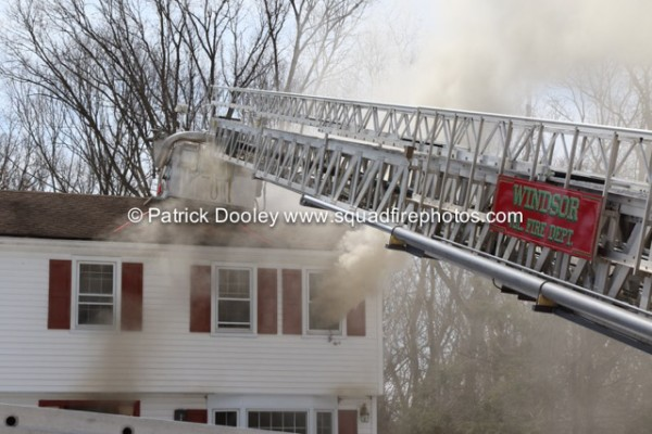 Sutphen tower ladder works at fire scene